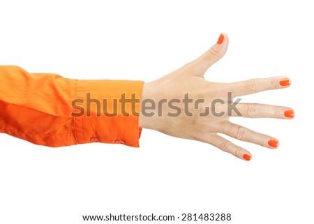 Female hand in orange shirt isolated on white background - stock photo