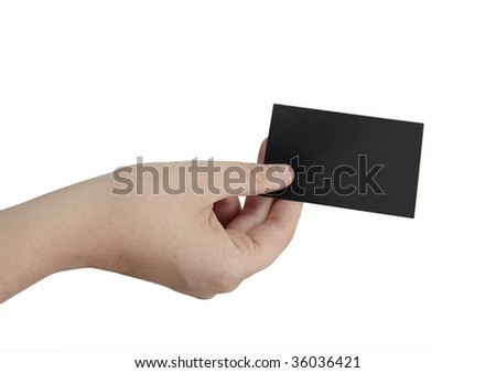 female hand is holding a black blank business card - stock photo