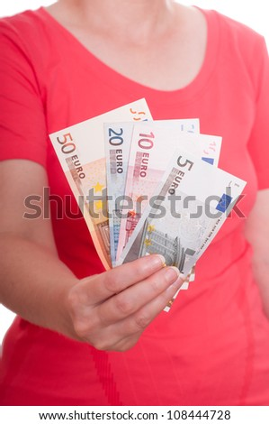 Female hand is holding euro notes - stock photo