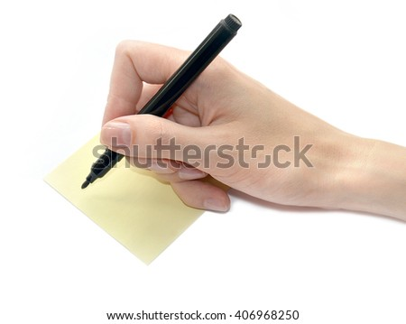 Female hand is ready for drawing with black marker and yellow leaf on a surface, Isolated on white - stock photo