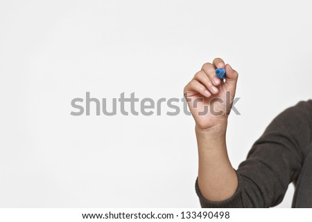 Female hand is ready for drawing with black marker. Isolated on white. - stock photo