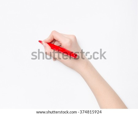 Female hand is ready for drawing with red marker