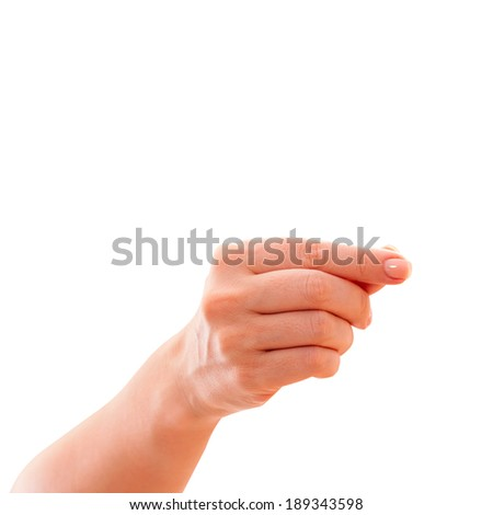 Female hand isolated on white background. Hand finger hand holds subject of an advertisement Isolated on white.  - stock photo