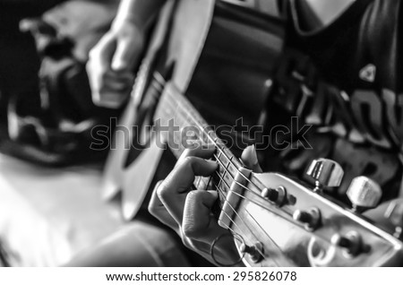 female hand on classical guitar , black and white color - stock photo
