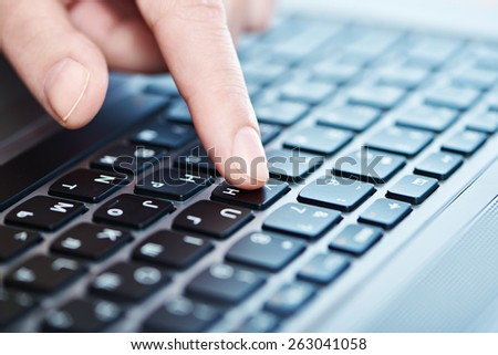 Female hand on laptop keyboard closeup - stock photo