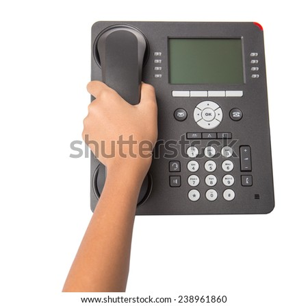 Female hand picking up desktop telephone handset over white background - stock photo