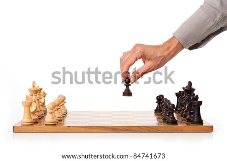 Female hand playing chess. White background. - stock photo