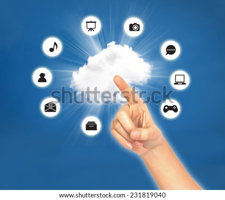 Female hand point on cloud with icon against blue sky . Cloud computing concept  - stock photo