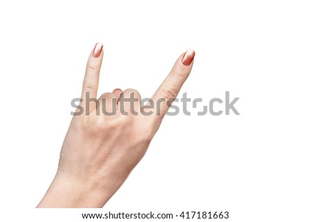 Female hand put up little finger and index finger showing horns isolated on a white background