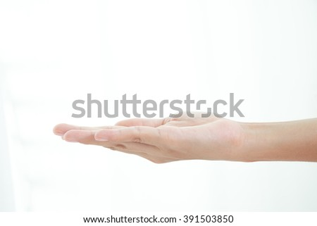 Female hand showing empty space for your choice