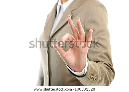 female hand showing ok over white background - stock photo
