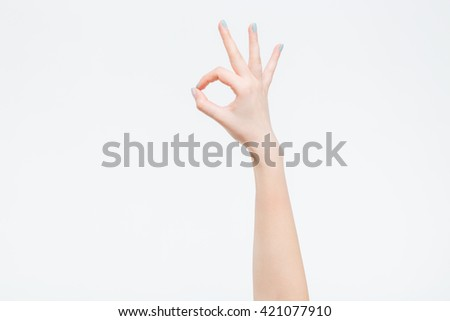Female hand showing ok sign isolated on a white background - stock photo
