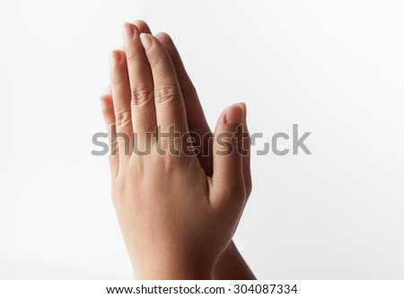 female hand showing prayer hand  Isolated on white background - stock photo