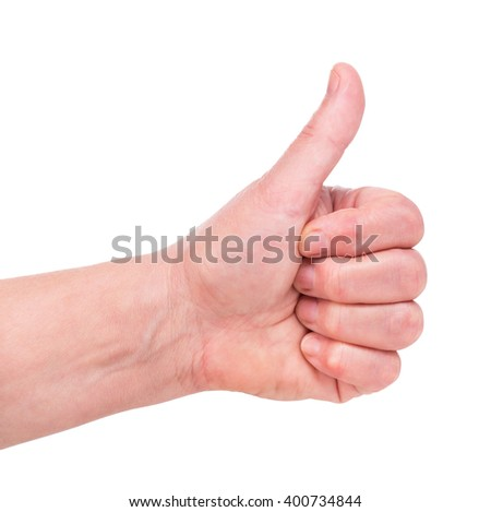 Female hand shows a gesture with thumb up isolated over white background