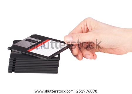 female hand takes a floppy disk over white background - stock photo