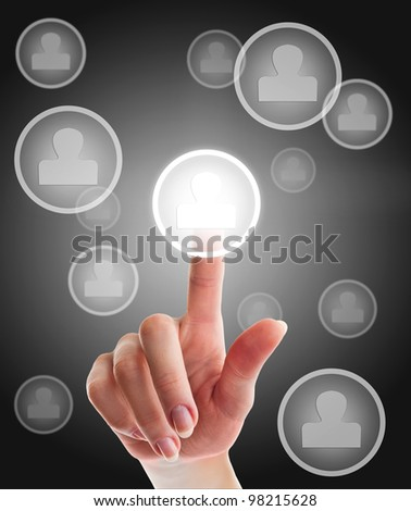 female hand touching human model icon connected in a social network over grey background - stock photo