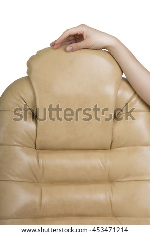 Female Hand Touching New Leather Office Boss Chair (armchair). Furniture Restoration and Replacing, update the Material. Work dermatin chair, light background. New Stylish Office Furniture - stock photo