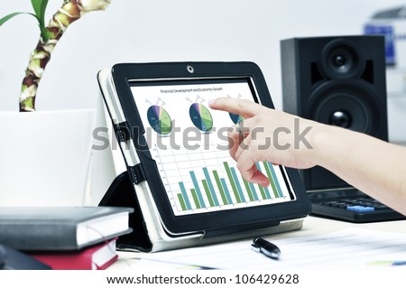Female hand touching on modern digital tablet pc at the workplace. - stock photo