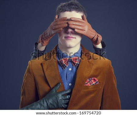 Female hand turning a blind eye stylish men - stock photo
