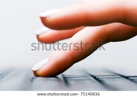 Female hand typing - stock photo