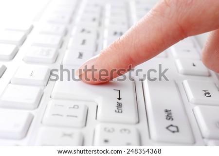 Female hand typing on keyboard, macro view - stock photo