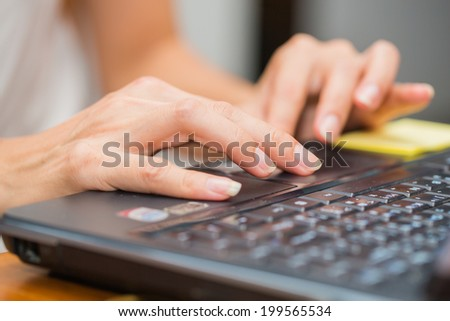 Female hand typing on laptop PC. - stock photo