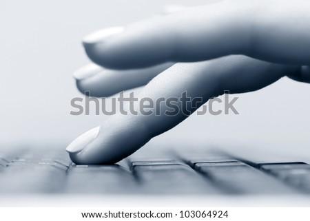 Female hand using computer keyboard - stock photo