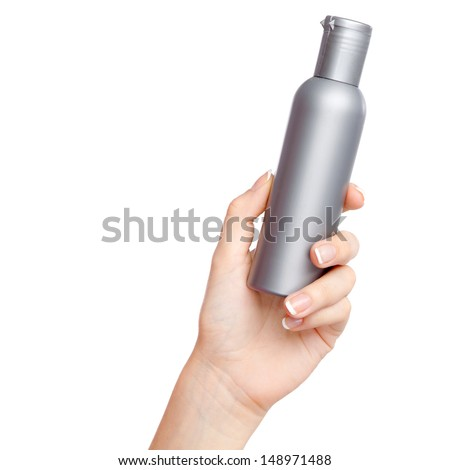 Female hand with a cosmetics bottle - stock photo