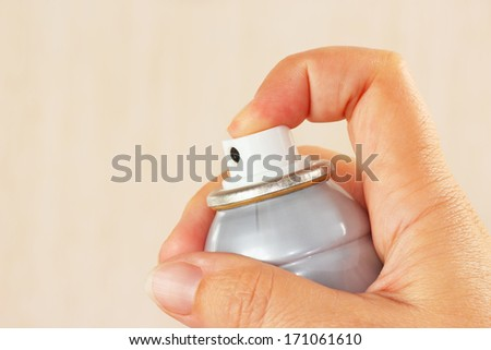 Female hand with a spray mist close up - stock photo