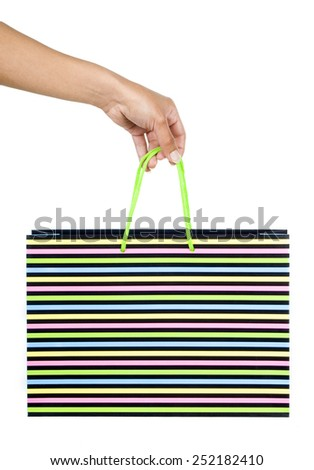 Female hand with bag a over white background - stock photo
