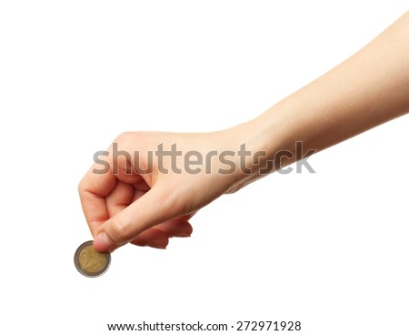 Female hand with coin isolated on white - stock photo