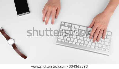 Female hand with computer keyboard isolated on white