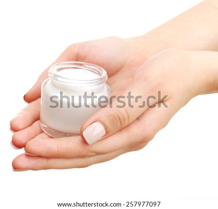 Female hand with cream isolated on white