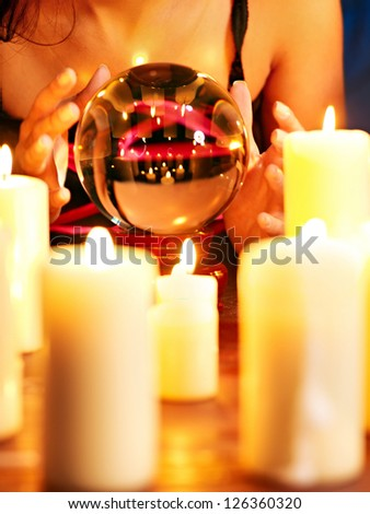 Female hand with crystal ball. Beauty and fashion. - stock photo