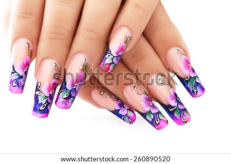 Female hand with floral art design nails  . - stock photo