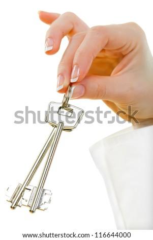 Female hand with house key - stock photo