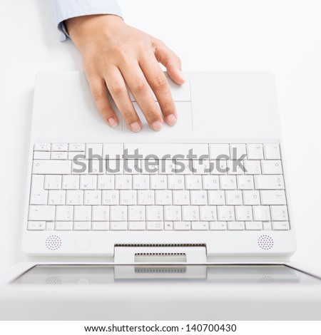 Female hand with laptop - stock photo