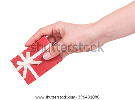 Female hand with little gift box isolated over white background - stock photo