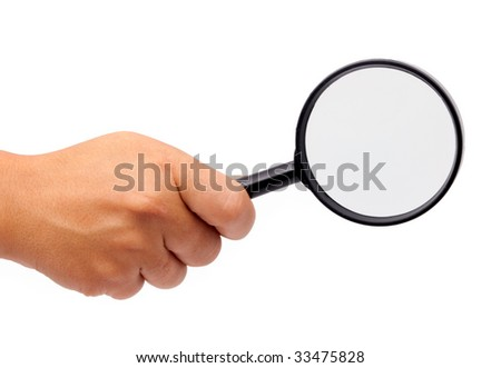 Female hand with magnifying glas isolated - stock photo