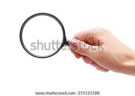 Female hand with magnifying glass.