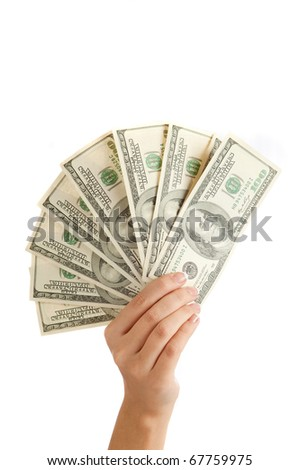 Female hand with money isolated on a white background