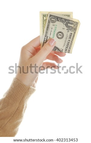 Female hand with money isolated on white