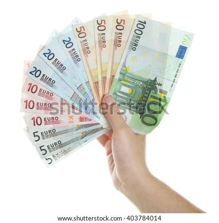 Female hand with money isolated on white - stock photo