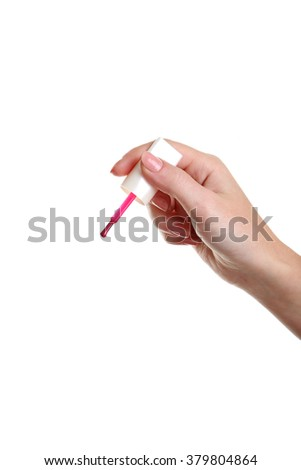 Female hand with nail polish isolated on white