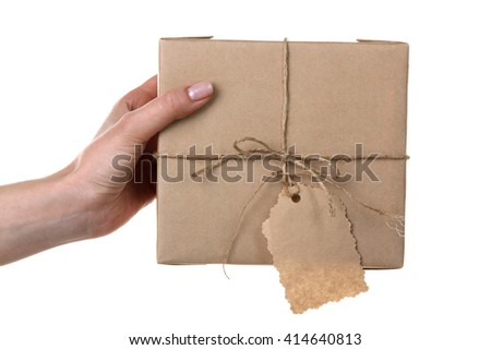 female hand with parcels on white isolated background.The concept of Delivery
