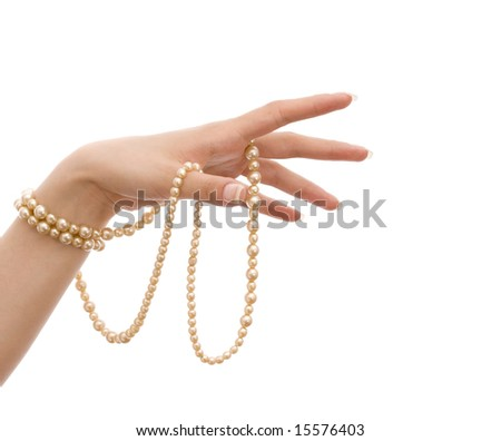 female hand with pearls