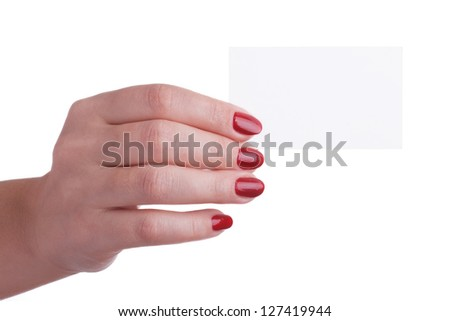 Female hand with red manicure holding a business card isolated on white background - stock photo