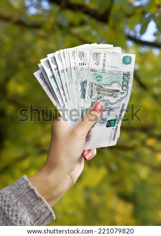 Female hand with Russian banknotes - stock photo