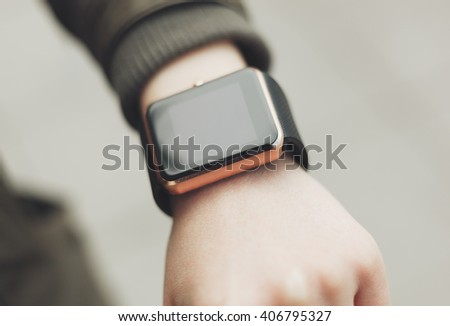 Female hand with smart watch. This new gadget lets you always stay connected to internet and social media networks from anywhere you want.