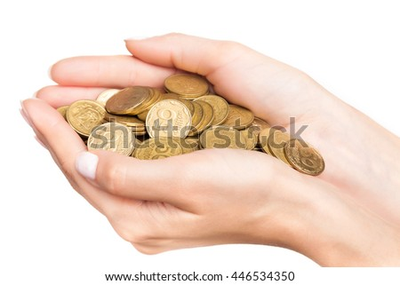 Female hand with stack of golden coins isolated on white background - stock photo